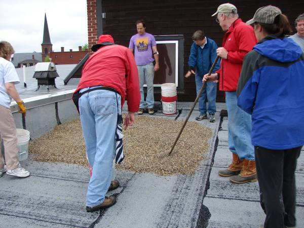Volunteers installing a gravel patch